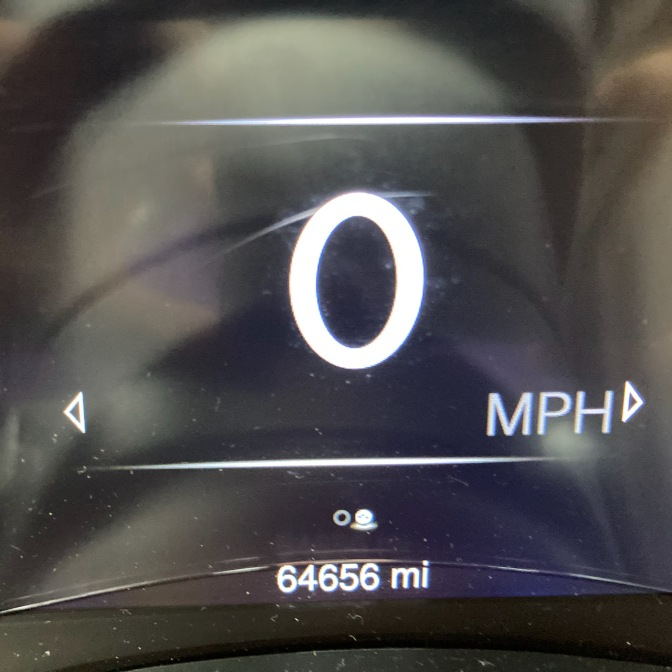 Car odometer reading 64656 miles