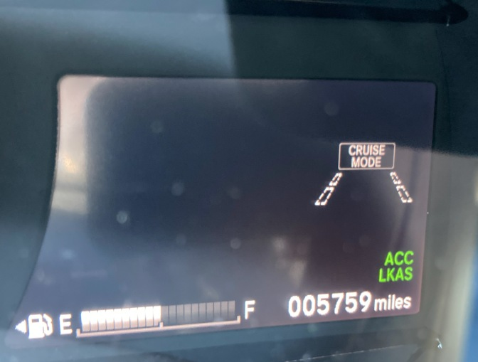 Screen with fuel gauge, cruise control indicator, odometer, and other safety systems.