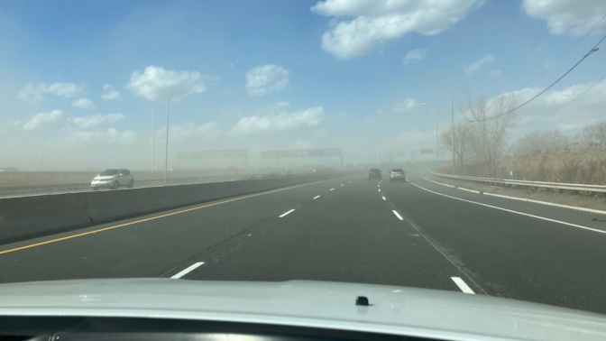 Sandstorm covering roadway.