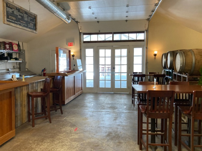Interior of Hawk Haven Winery, showing tables and bar.