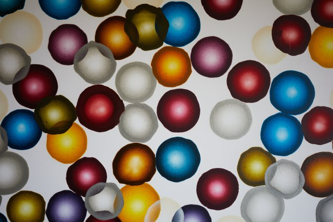 Painting of colored circles on canvas.