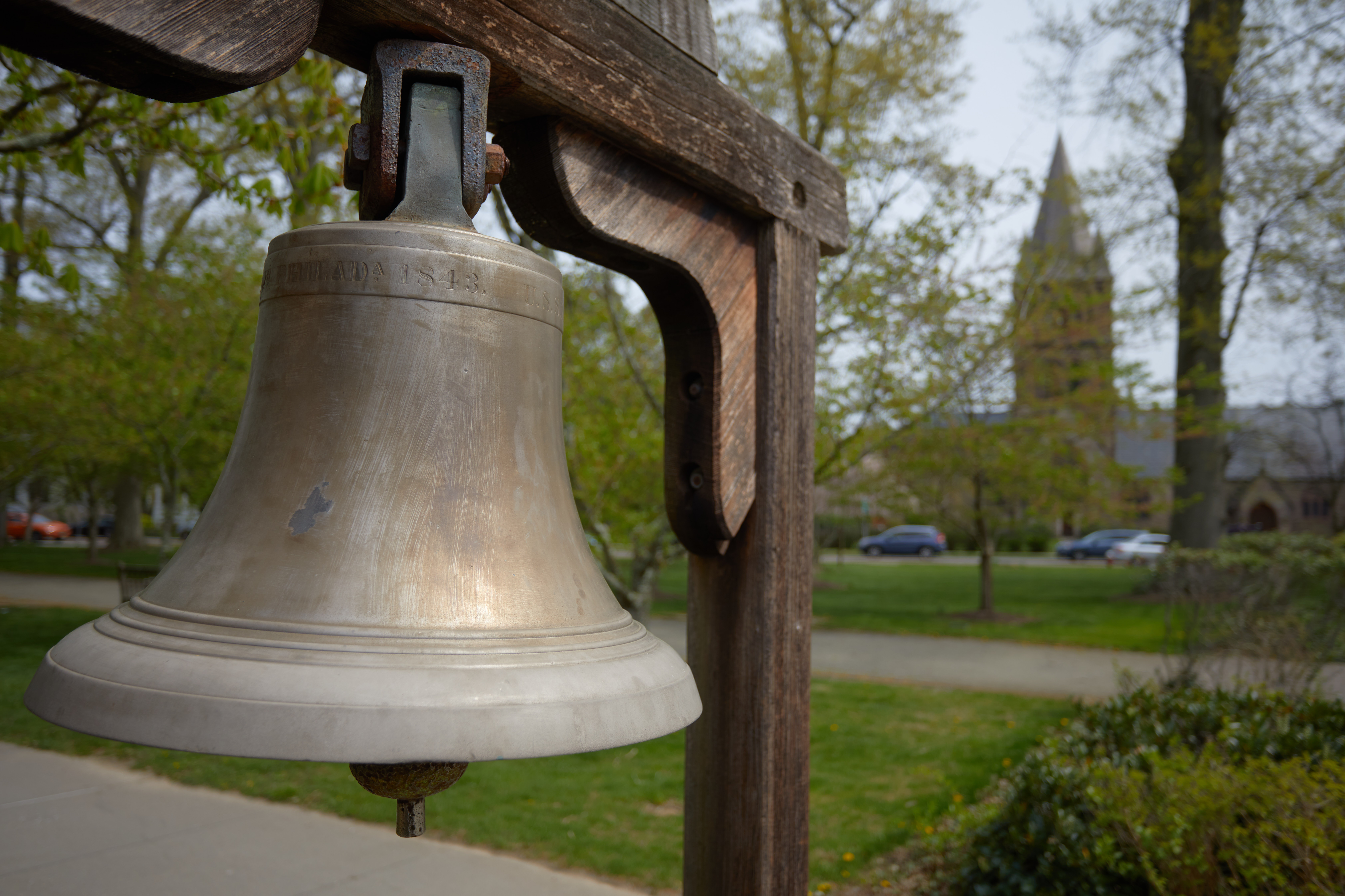 Bronze bell on wooden stand.