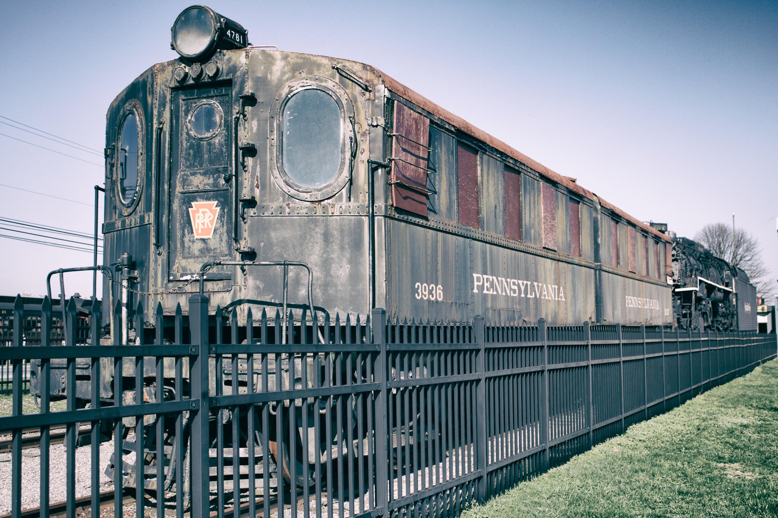 Electric train in train yard.