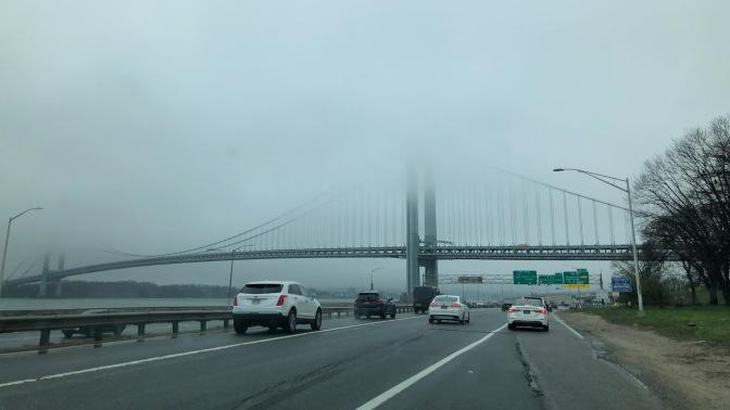 Verrazano-Narrows Bridge, with top of bridge covered in fog.
