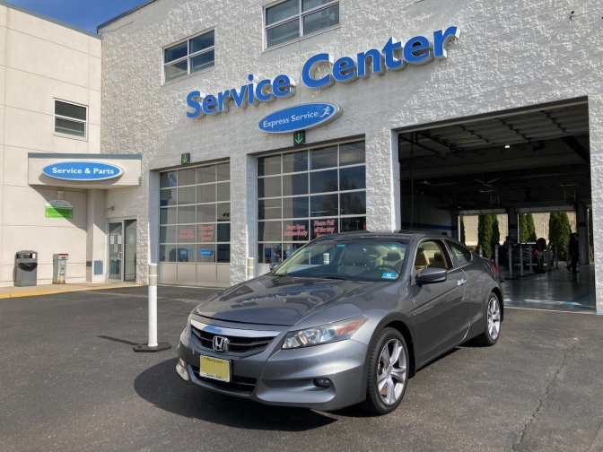 2012 Honda Accord parked in front of service center.