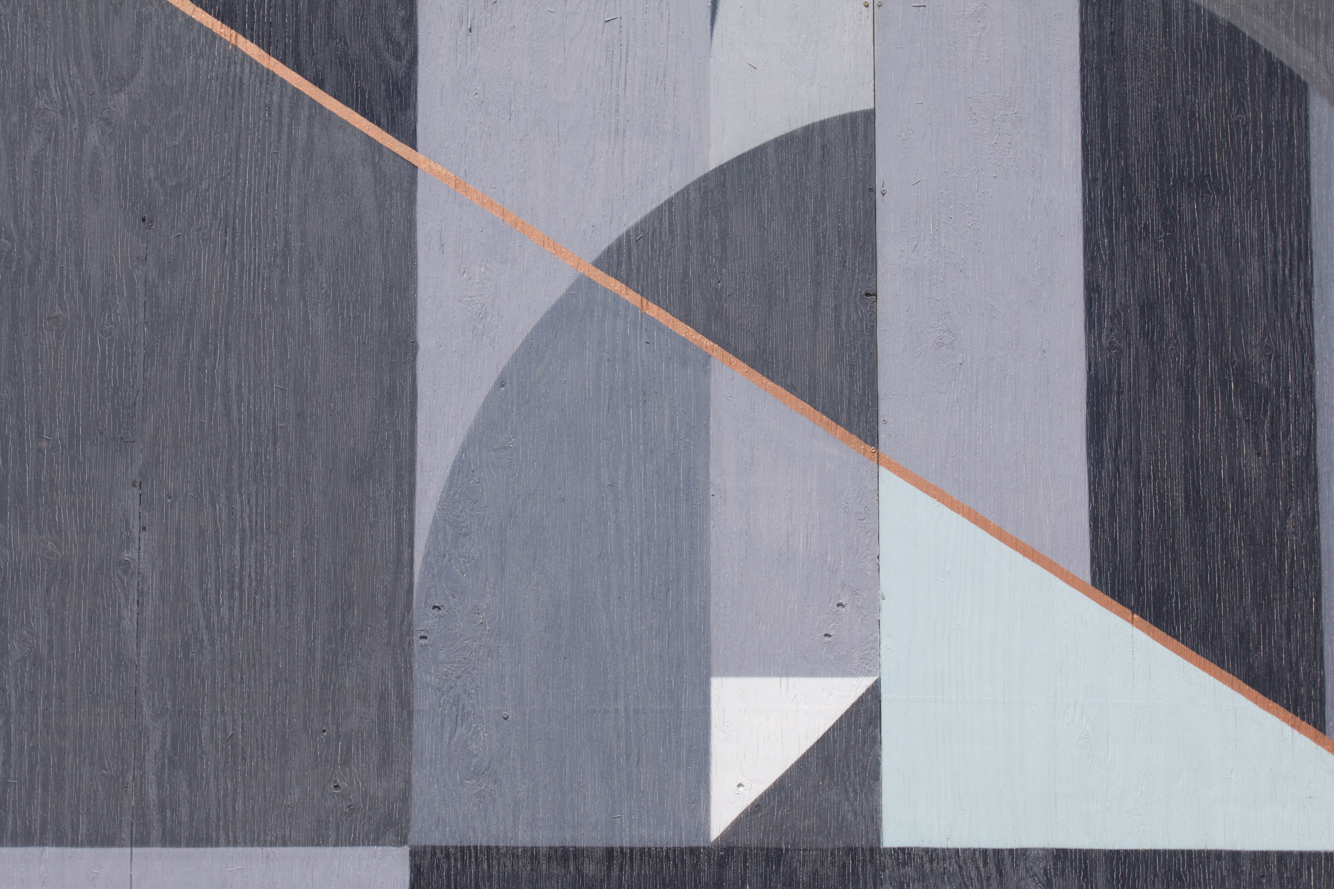 Gray and blue mural with shapes and lines.