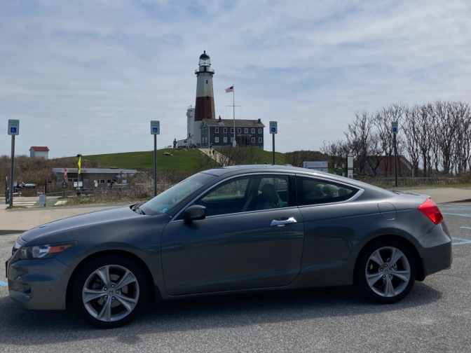 2012 Honda Accord parked in lot, with Montauk Point lighthouse in distance.