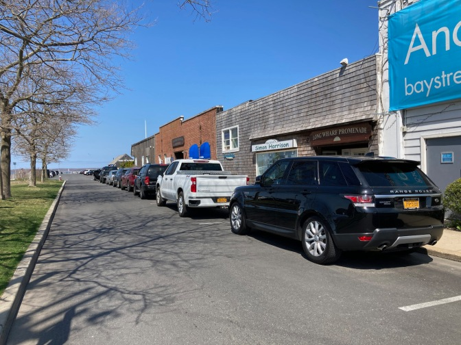 View of Long Wharf in Sag Harbor, with businesses lining the street.