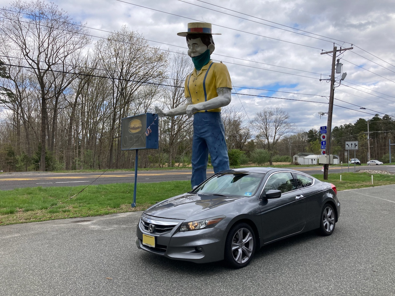 2012 Honda Accord parked in front of statue of man wearing hat and mask.