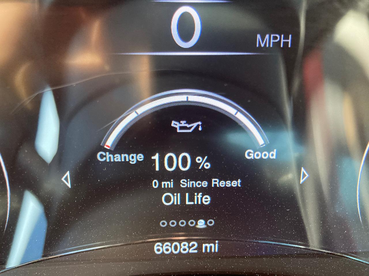 Car maintenance minder showing 100% oil life