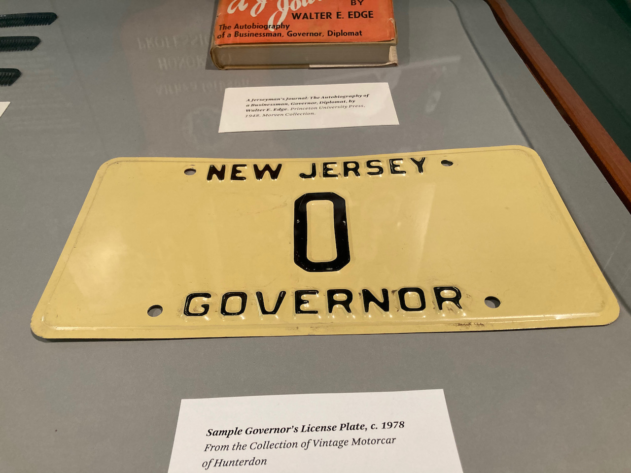 Display case with license play that reads NEW JERSEY 0 GOVERNOR.