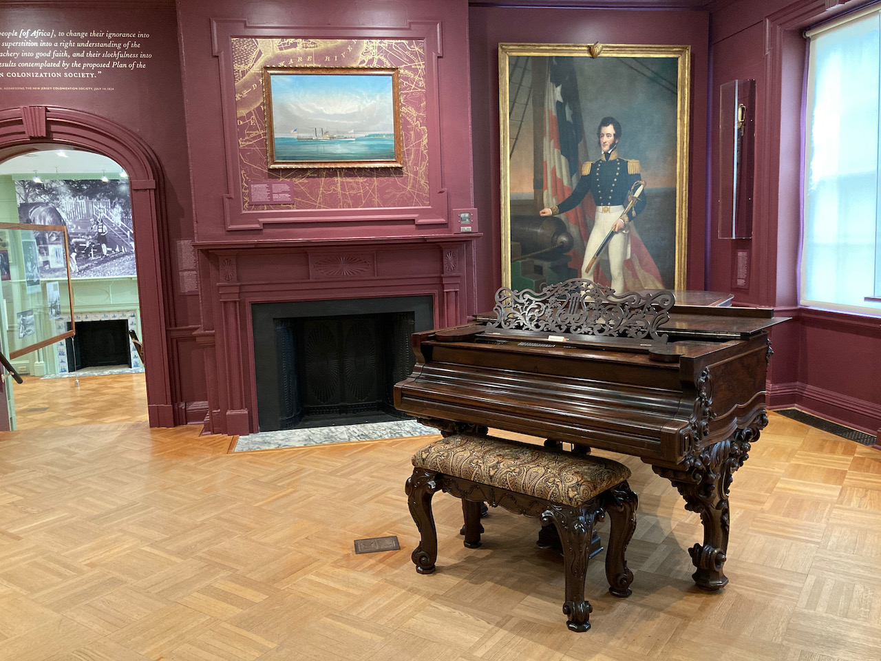 Room with grand piano and portrait of Robert Stockton.