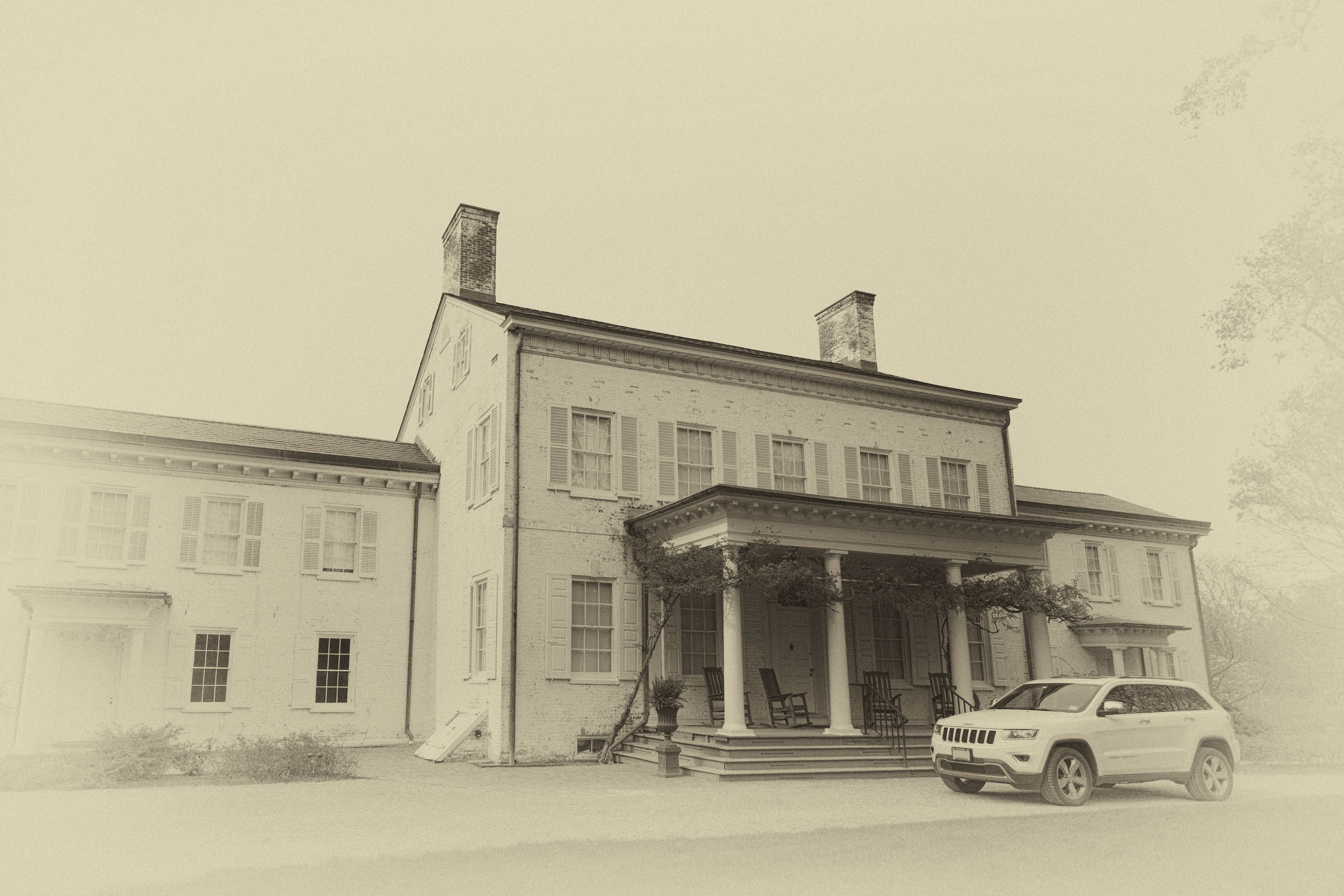 Morven Museum with 2014 Jeep Grand Cherokee parked in front of it, in sepia tone.