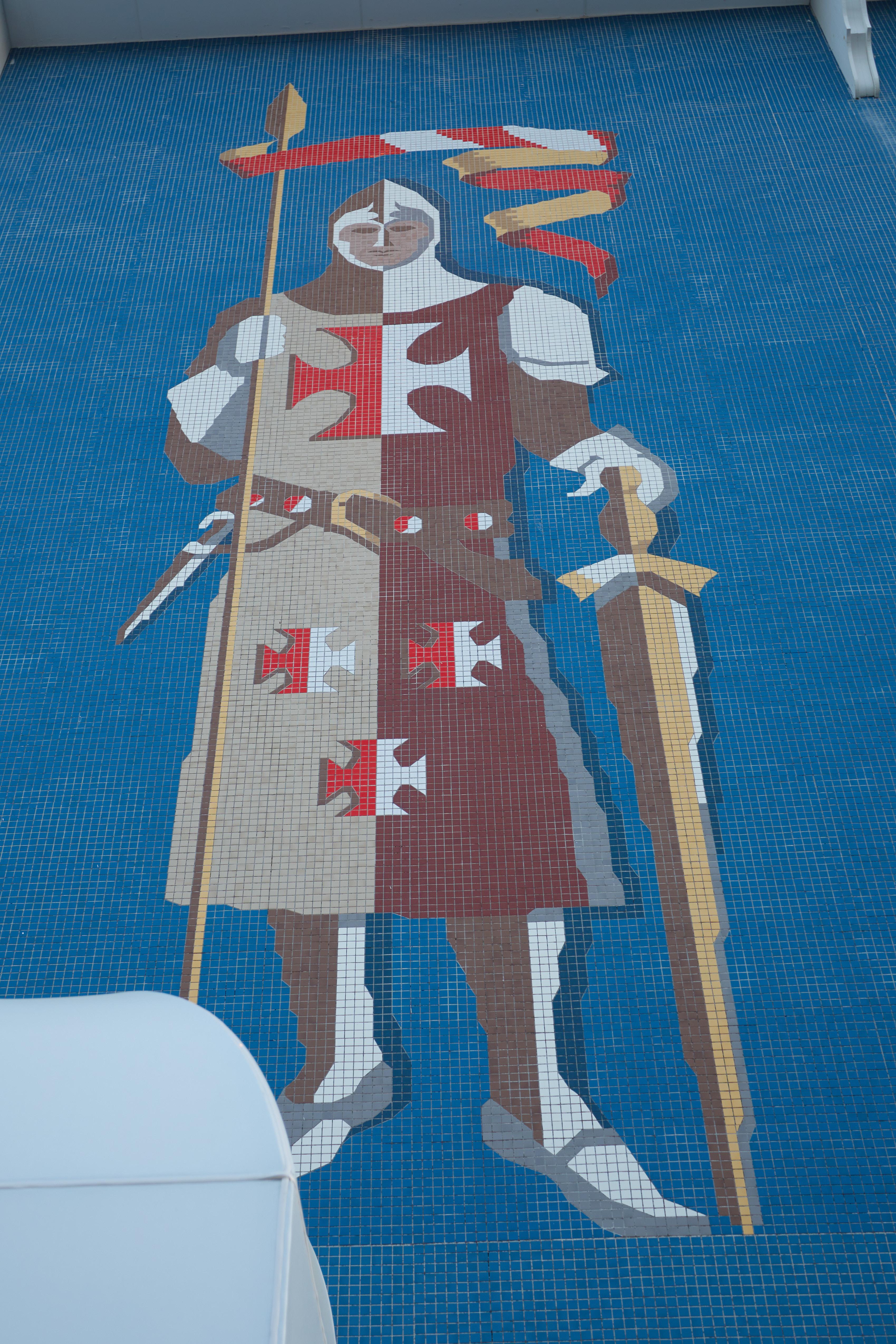 Tile Crusader knight on side of building.