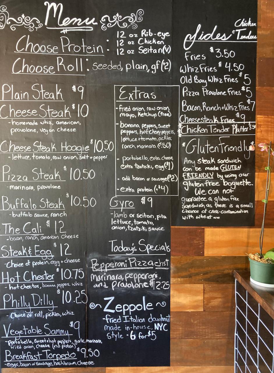 Blackboard menu in restaurant listing all options.