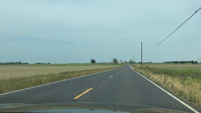 County two-lane road through farmland.