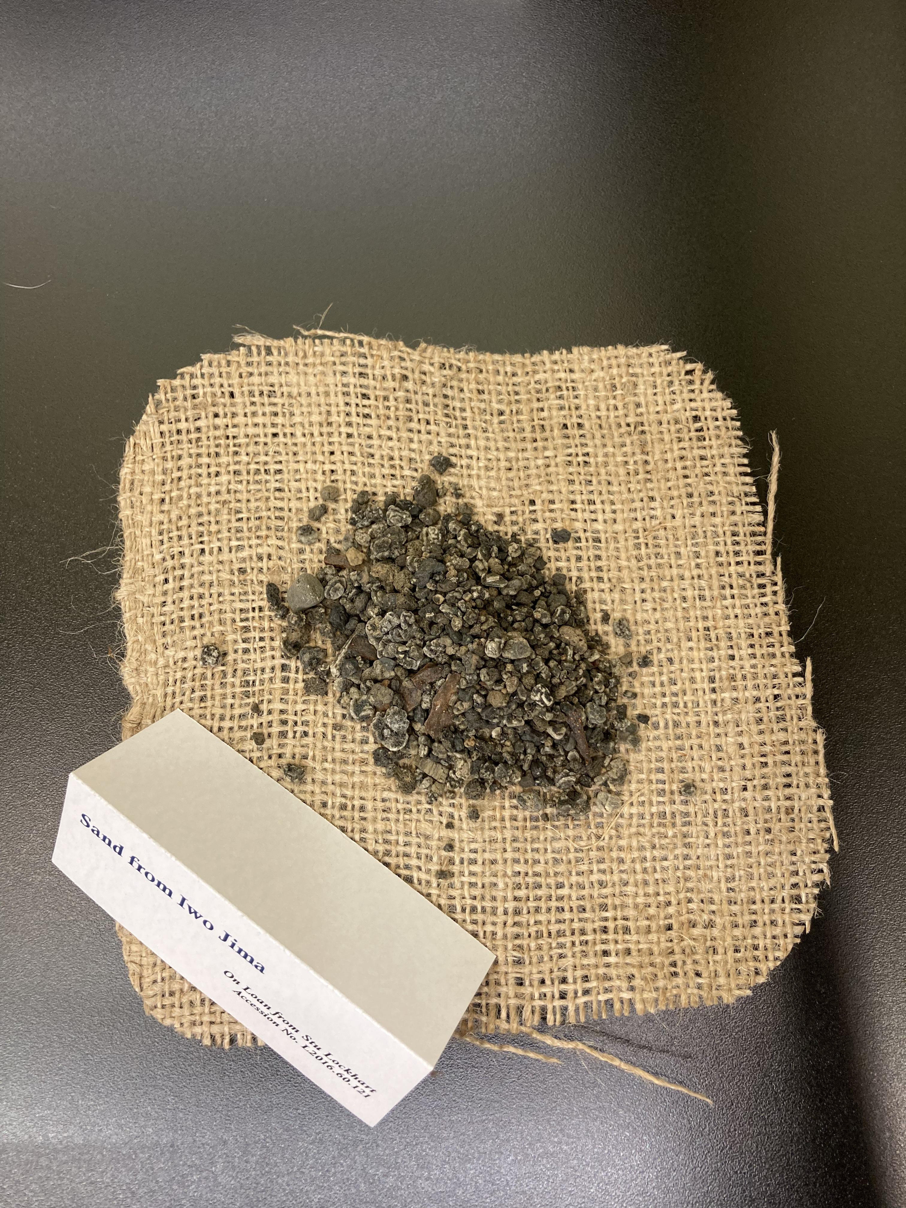 Sand from Iwo Jima, on cloth napkin.