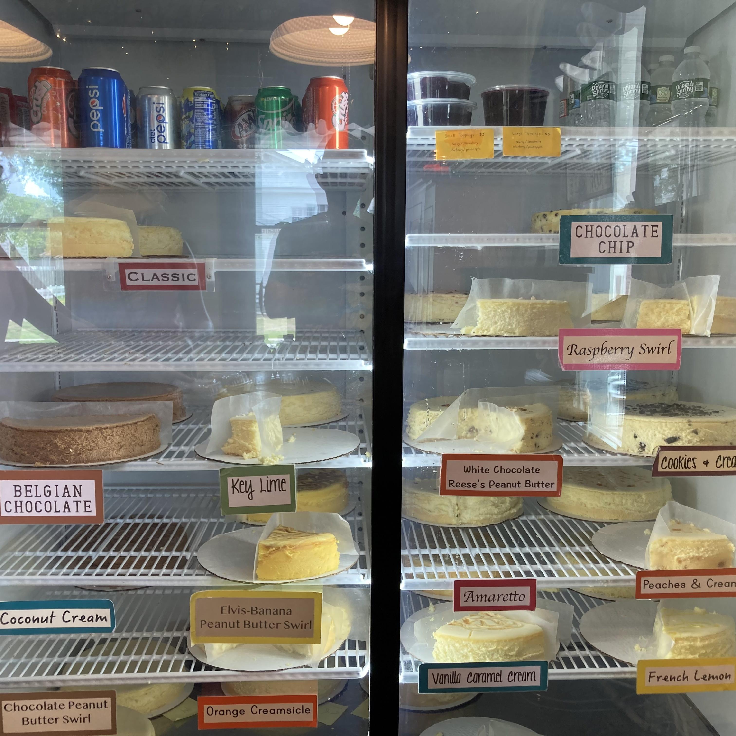 Refrigerator full of cheesecakes.