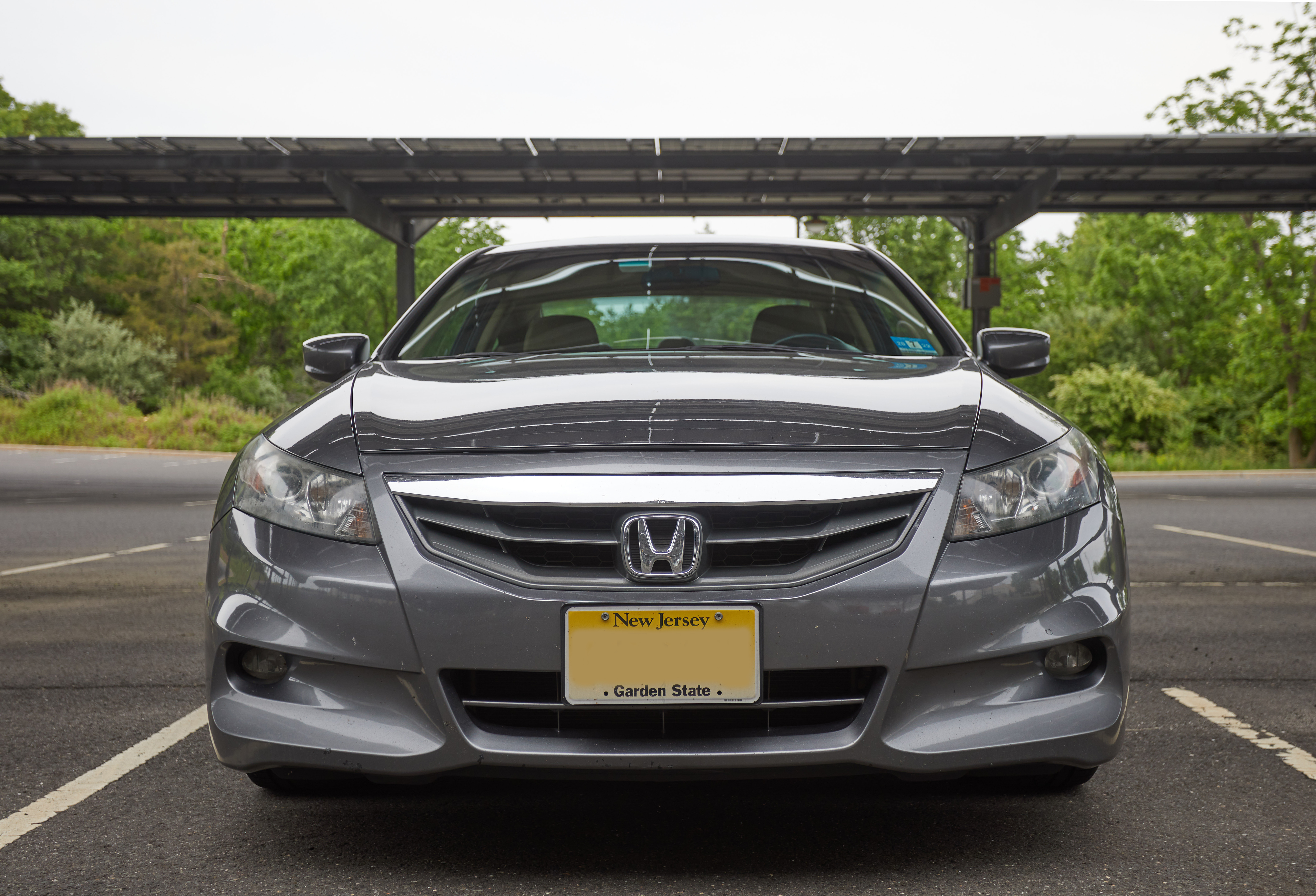 Front end of 2012 Honda Accord coupe, parked in parking lot.