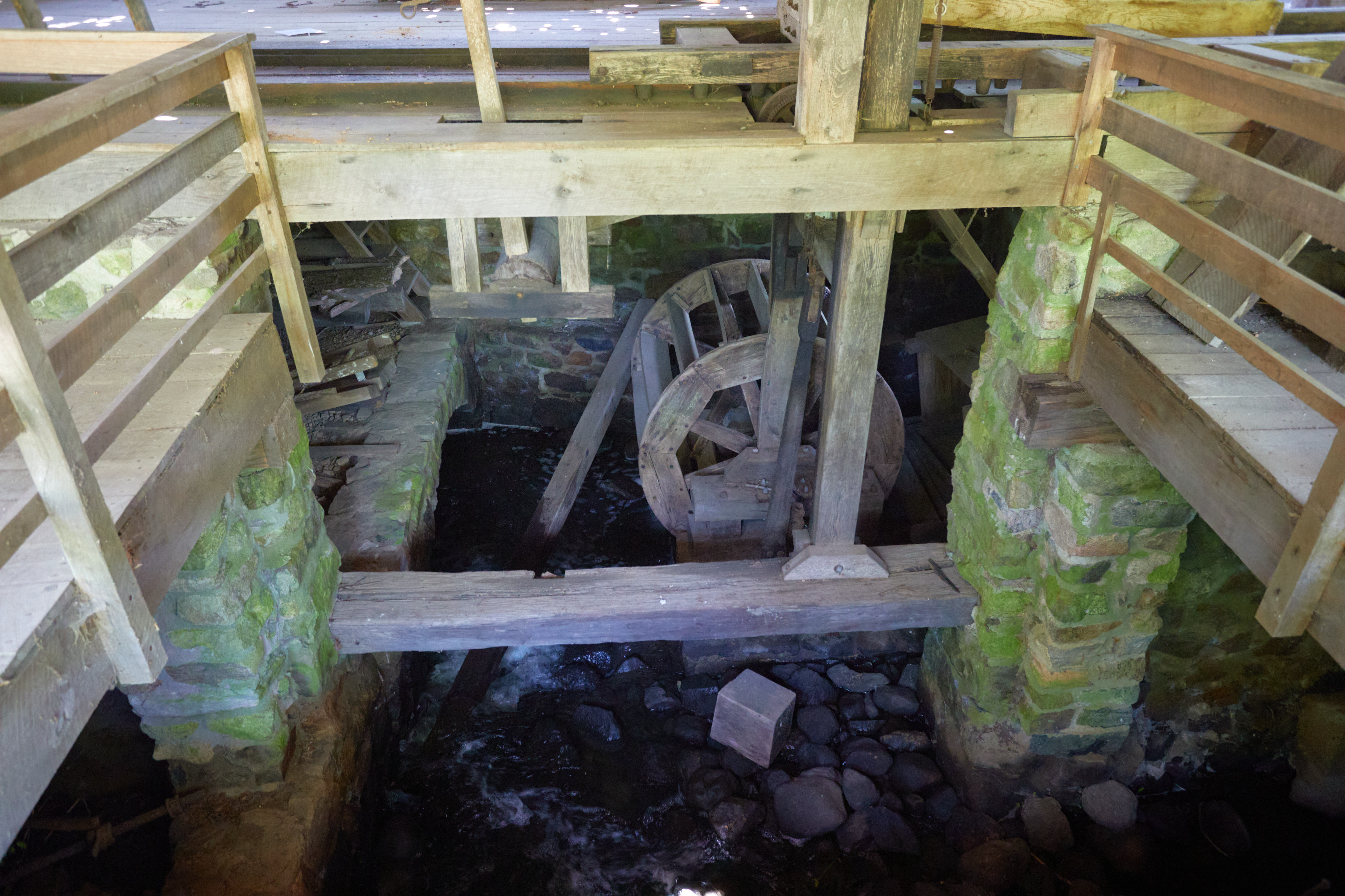 View of water wheel beneath gristmill.