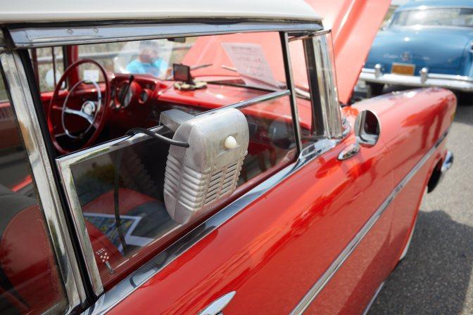 Small metal speaker on window of Chevrolet Bel-Air.