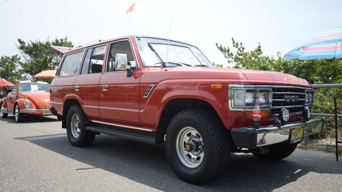 Red Toyota Land Cruiser.
