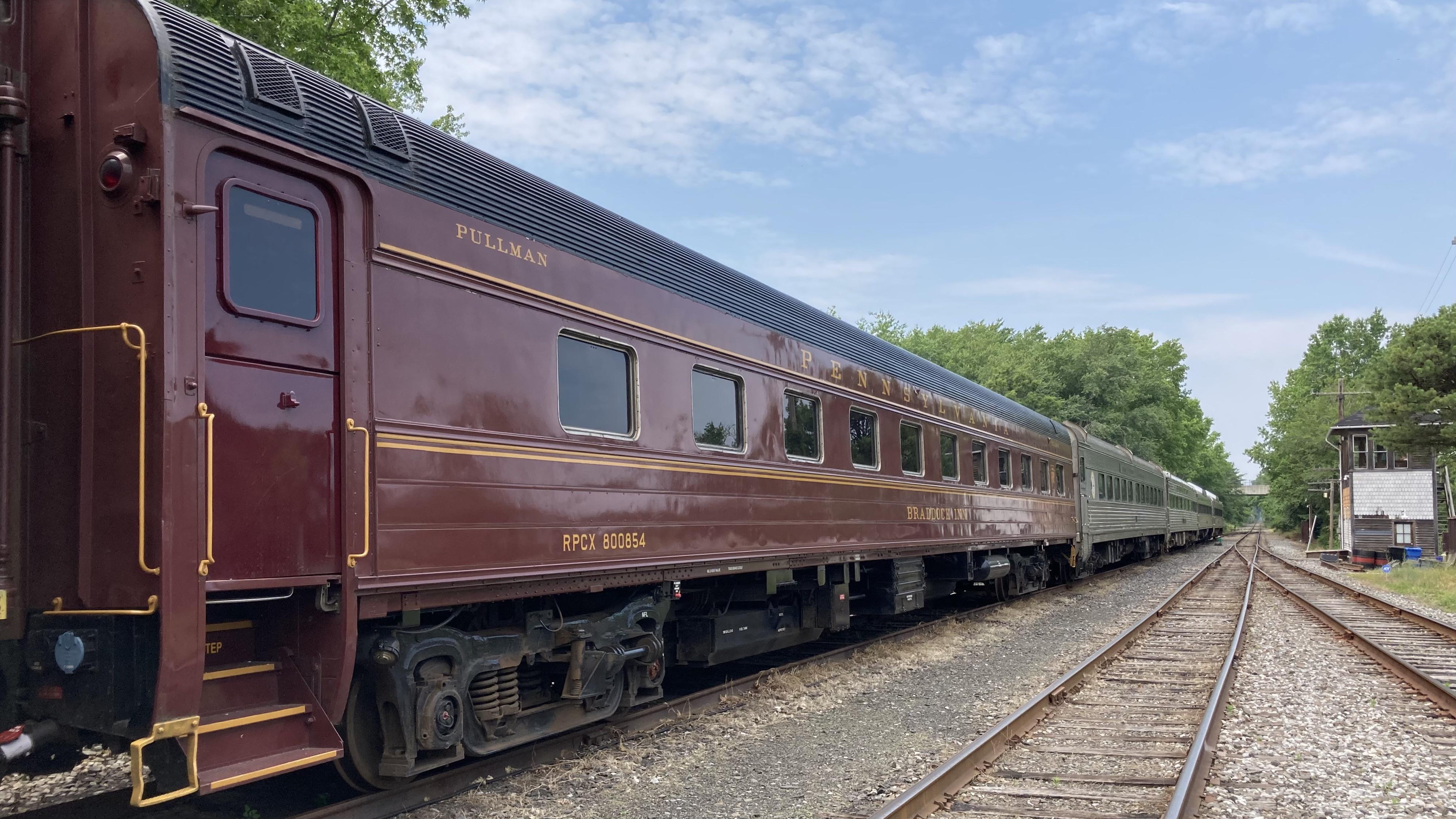 Pullman passenger car in train yard.