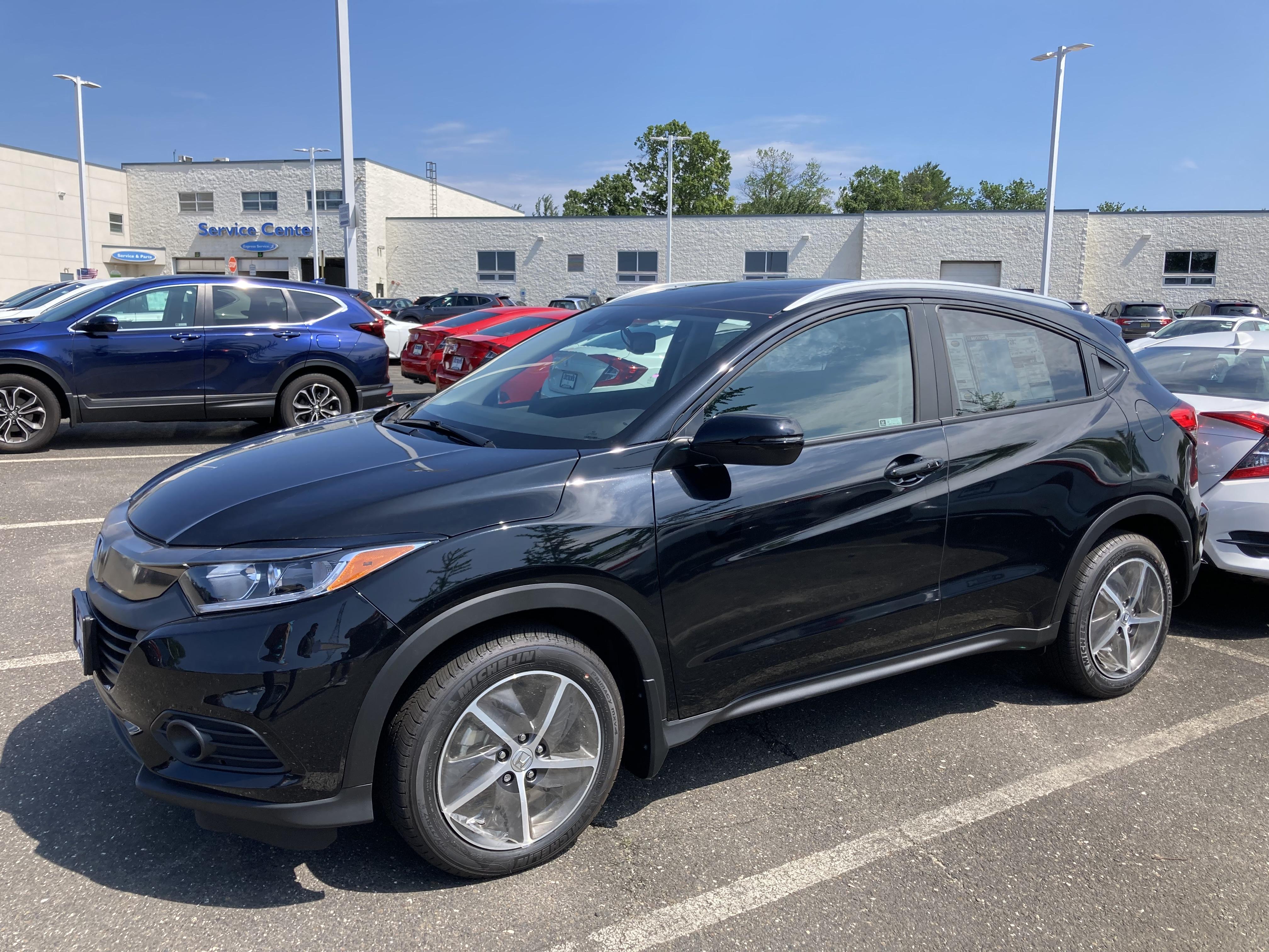 Black Honda HR-V on dealership lot.