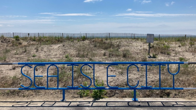 Steel fence with words SEA ISLE CITY in metalwork.