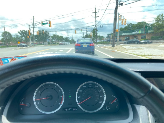 View of roadway from behind dashboard of 2012 Honda Accord.