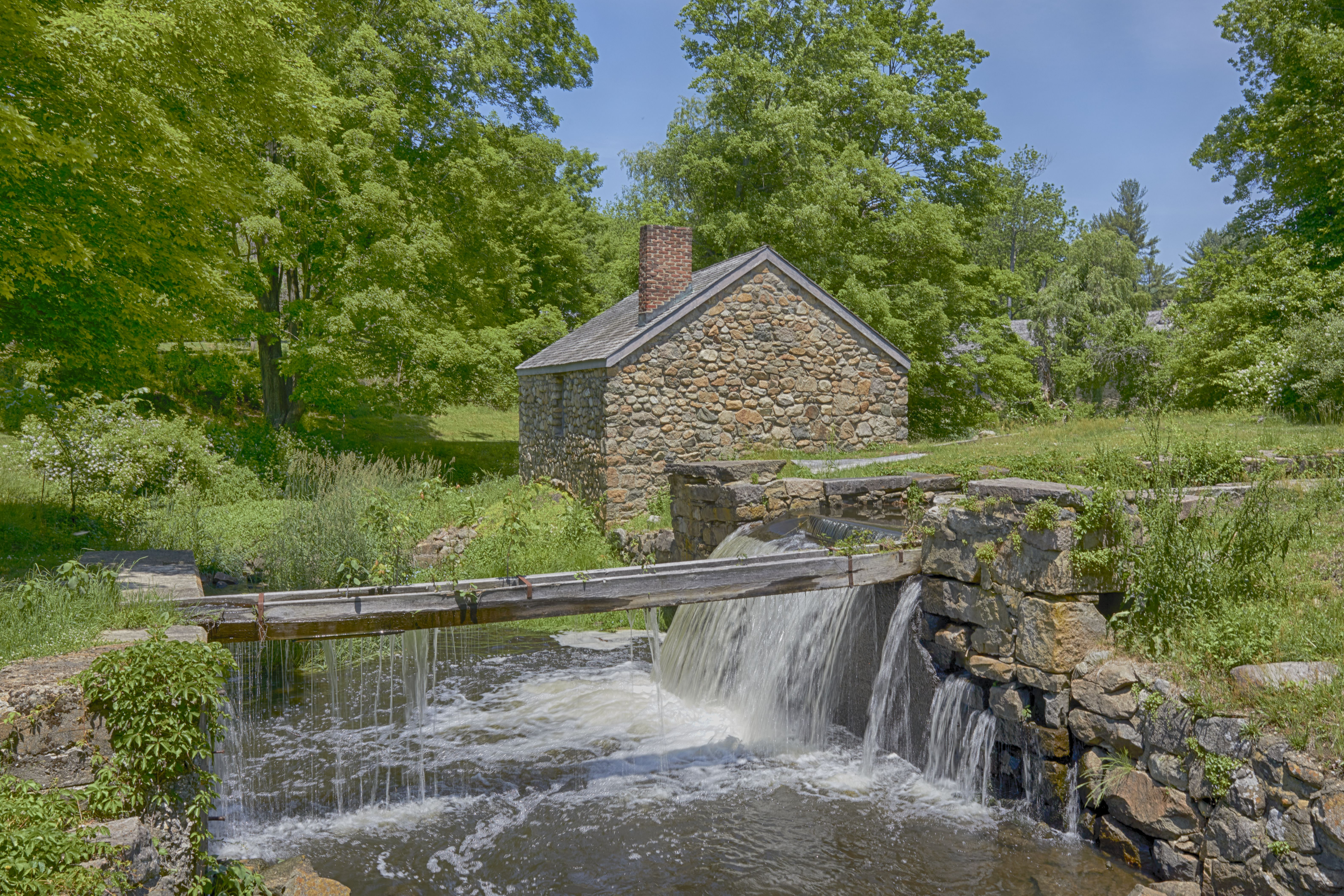 Small stone building beside canal lock.