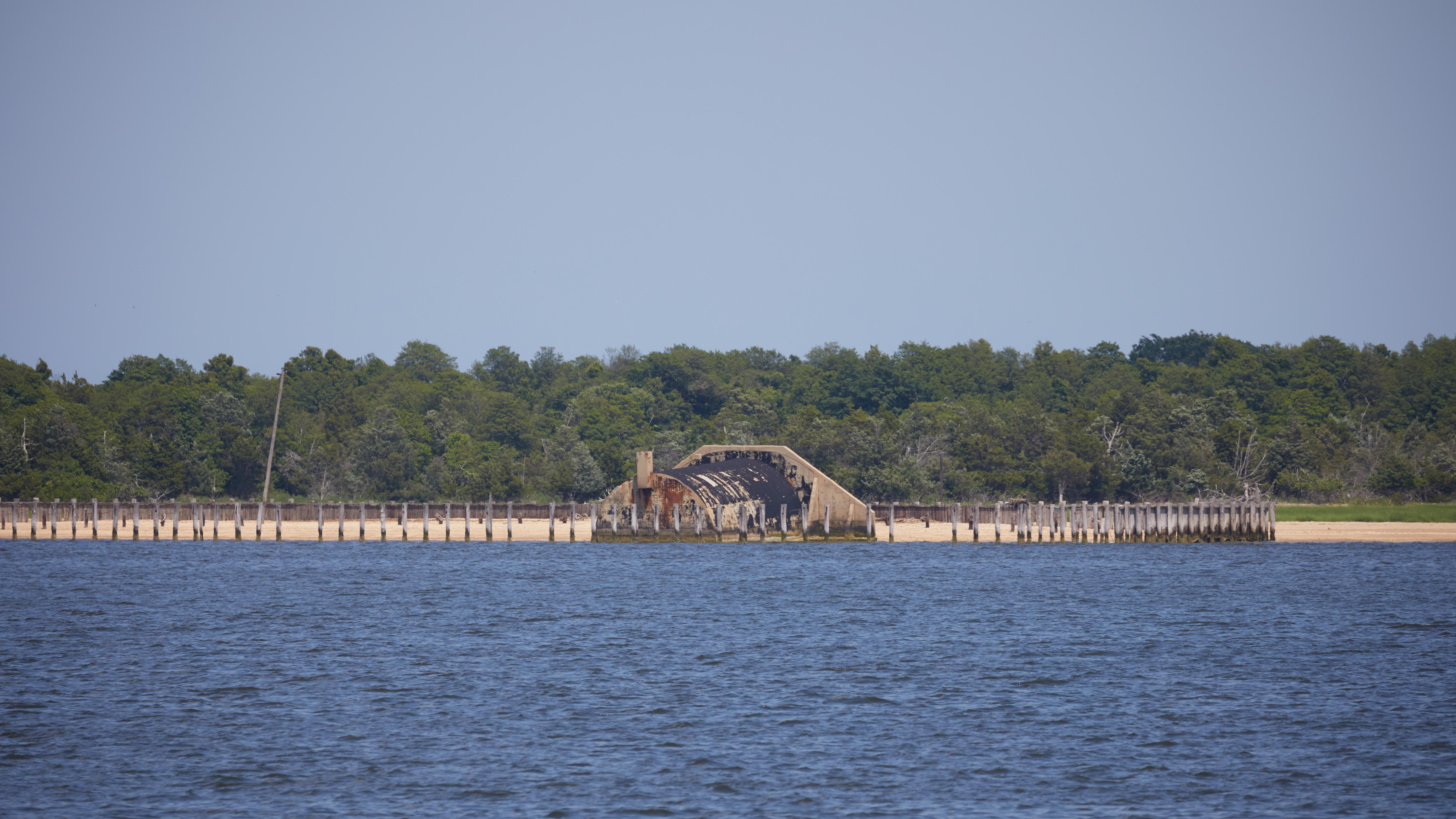 View of concrete bunker along shore of Sandy Hook.