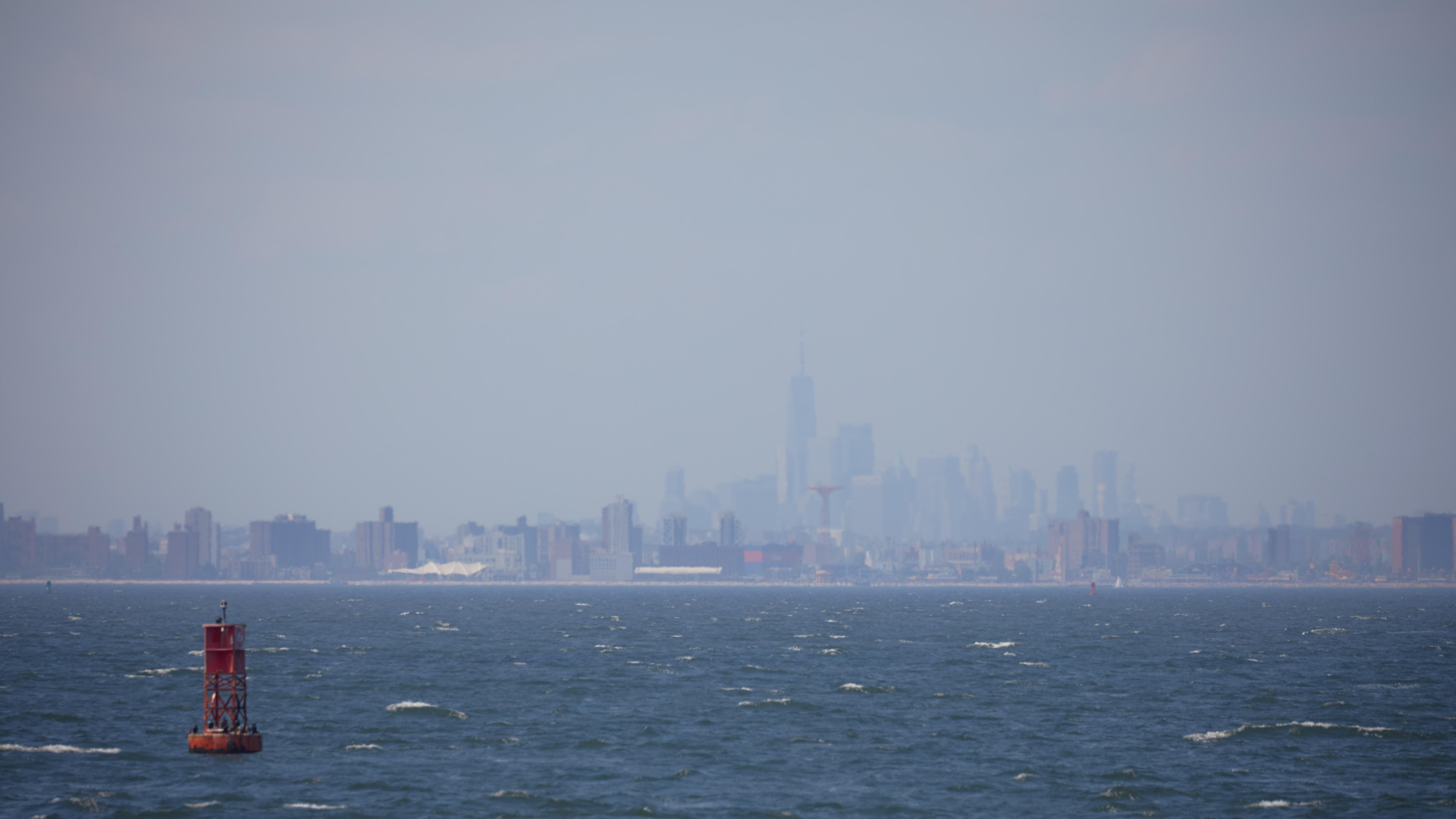 View of Manhattan skyline covered in haze.
