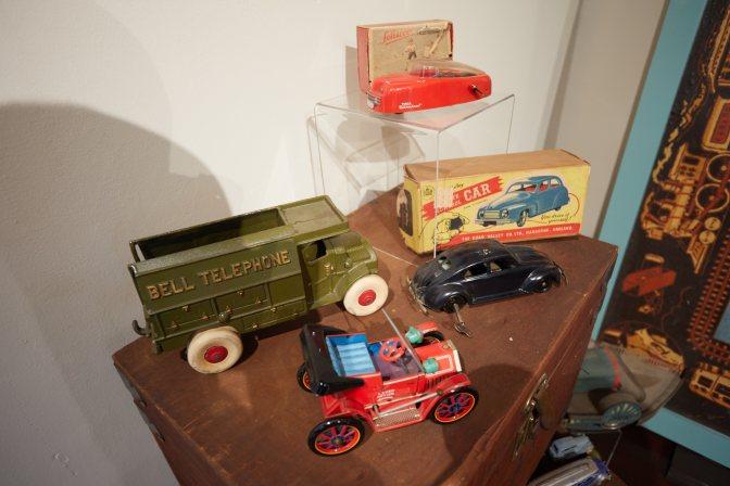 Toy cars on shelf.
