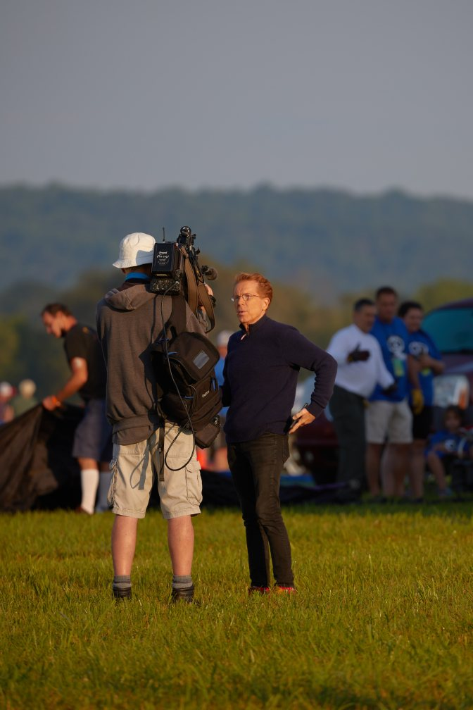 TV personality John Elliott in front of cameraman.