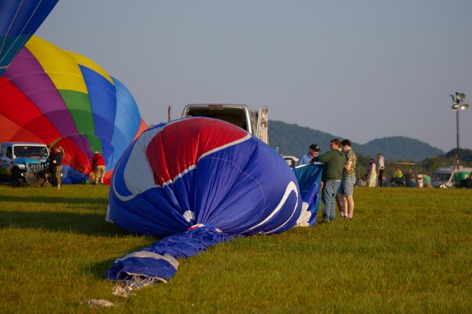 Blue Balloon beginning to inflate on ground.