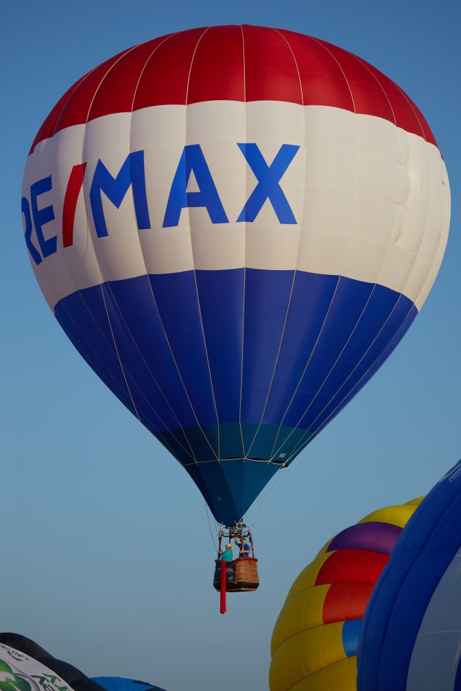 Large blue-and-white RE/MAX balloon.