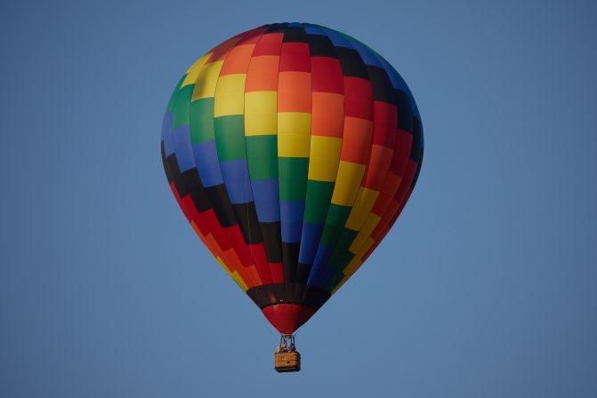 Multicolored balloon in sky.