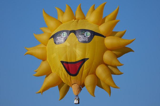 Hot air balloon of the sun, wearing sunglasses.