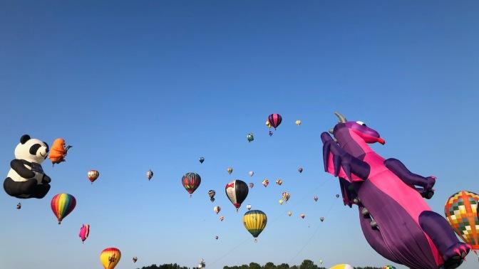 Balloons in flight in air.