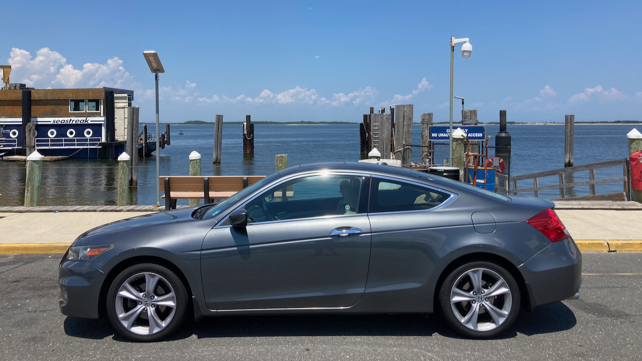 2012 Honda Accord coupe parked in front of ferry terminal.