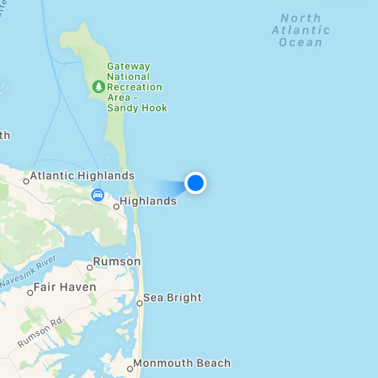 Map of Sandy Hook, with blue dot indicating boat location in Atlantic Ocean.