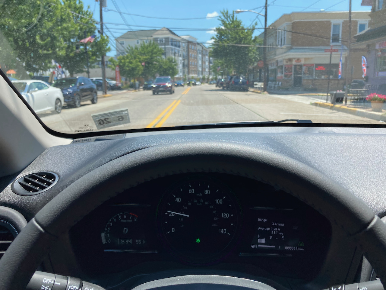 View of roadway, from behind wheel of Honda HR-V.