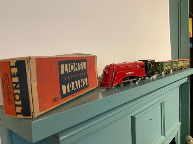 Lionel toy trains on mantelpiece.