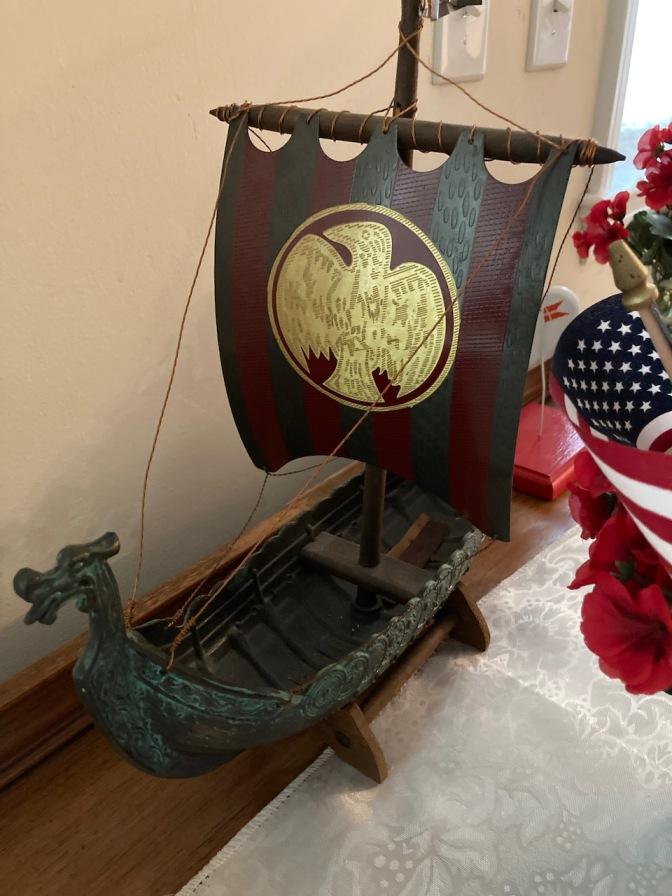 Model of Viking ship on desk.