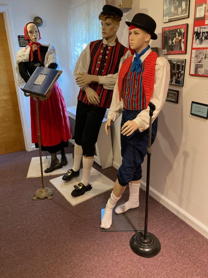 Three mannequins with Danish dancing attire.
