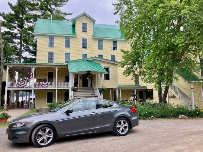 2012 Honda Accord parked in front of The Woods Inn.