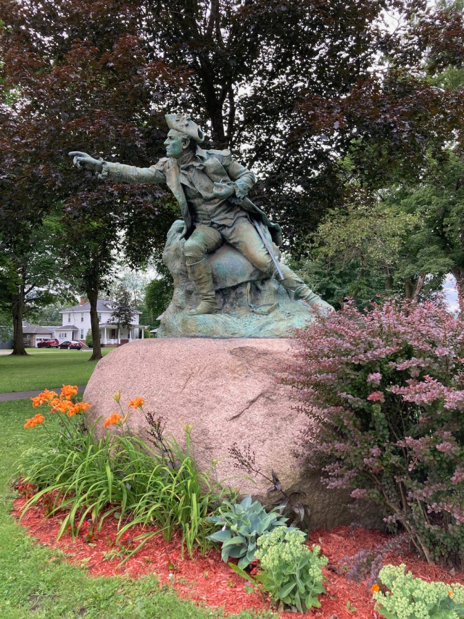 Statue of General Herkimer in park.