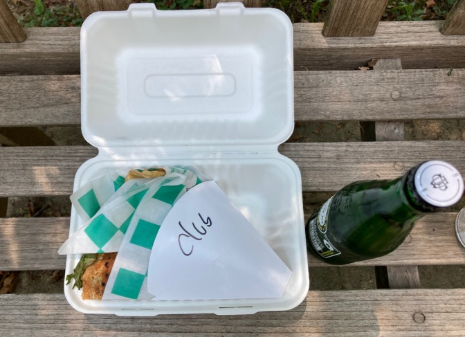 Paper box with crepe, and a ginger ale.
