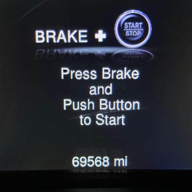 Car odometer reading 69568 miles.